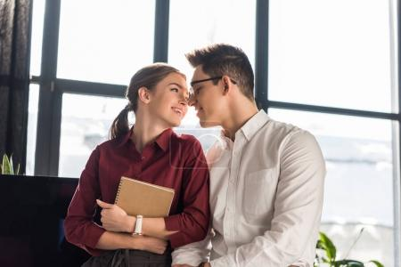 young managers couple at office, workplace romance concept