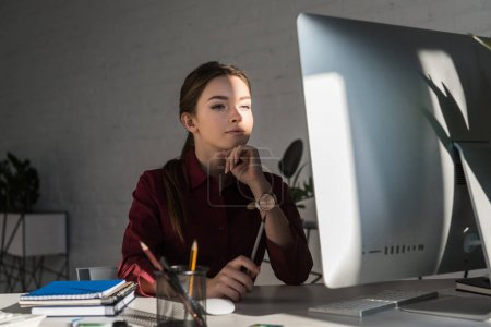 beautiful young businesswoman working with computer at modern office