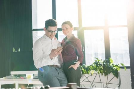 young businesspeople couple at modern office