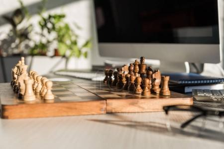 Photo for Close-up shot of chess board at office work desk - Royalty Free Image