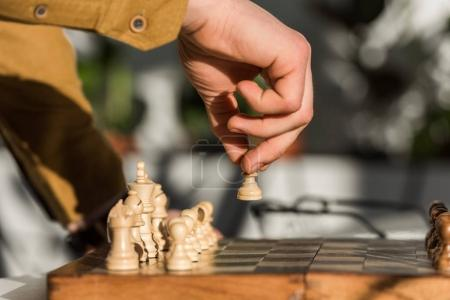 Photo for Cropped shot of man making move while playing chess - Royalty Free Image