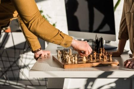 Photo for Cropped shot of managers playing chess at work desk - Royalty Free Image