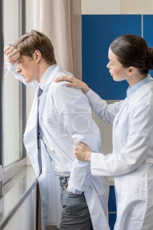 Upset doctor thinking
