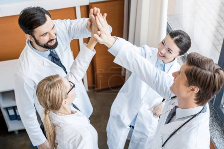 doctors team giving highfive