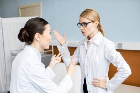 Professional doctors talking