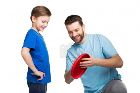 Father and son playing with frisbee