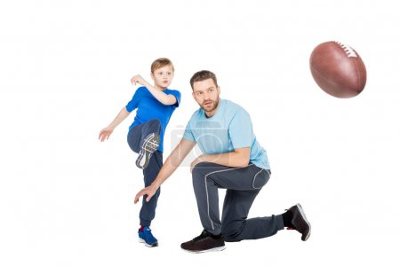 father with child playing football
