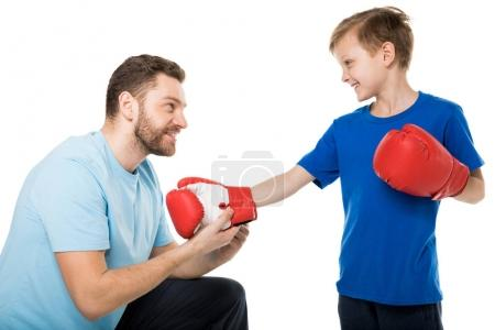 Father with son during boxing training