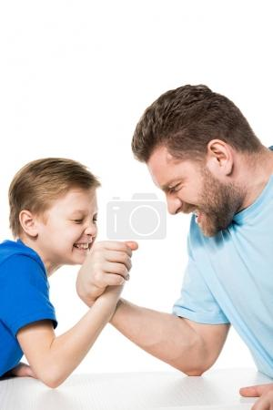 Son with father arm wrestling