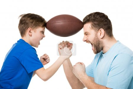 Father and son with rugby ball