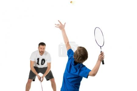 Father and son playing tennis