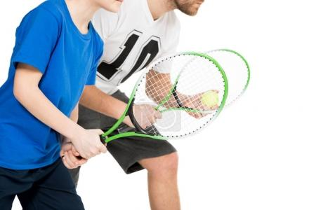 father and son with tennis racquets