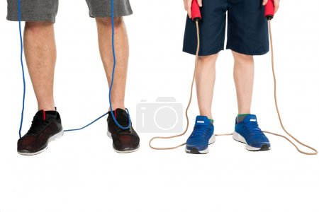 Photo for Partial view of father and son with skipping ropes isolated on white - Royalty Free Image