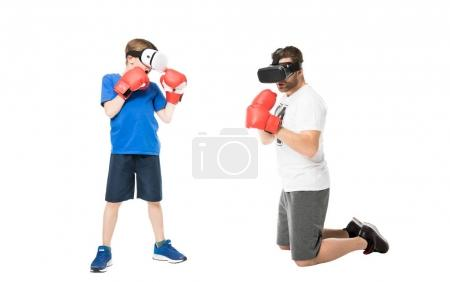 Photo for Side view of father and son boxing in virtual reality headsets isolated on white - Royalty Free Image