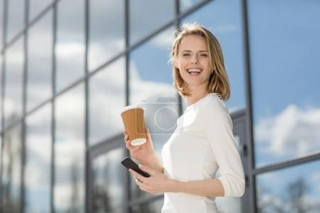woman with coffee and smartphone