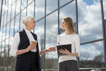 Businesswomen on meeting outdoors