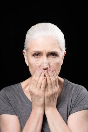 scared grey hair woman