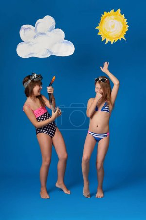 Beautiful girls in swimsuits and sunglasses, fun, dance and show emotions.