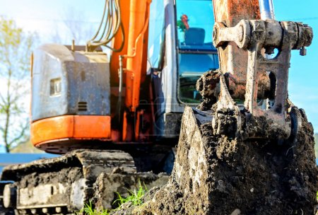 Excavator stand in construction site