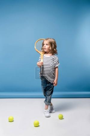 little girl with tennis equipment