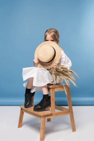 little girl with wheat ears