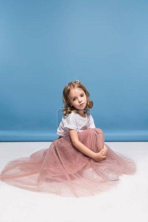 Little girl in pink skirt