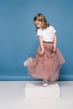 Little girl in pink skirt