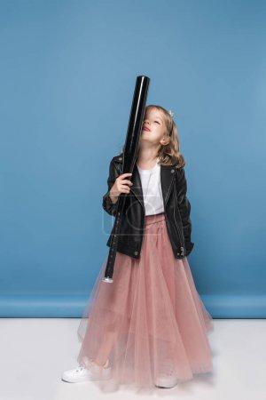 Adorable girl with baseball bat