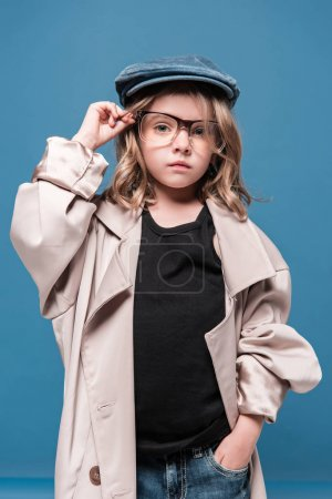 kid girl in glasses and oversized coat
