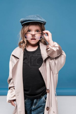 Child girl in glasses and oversized coat