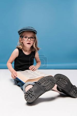 caucasian kid girl reading book