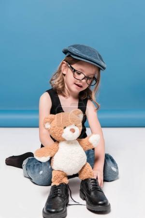 kid girl playing with teddy bear