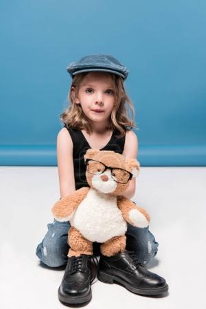 kid girl holding teddy bear