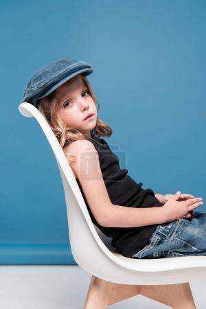 stylish kid girl sitting on chair