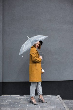 Fashionable woman with umbrella