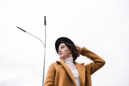 Caucasian woman in stylish hat