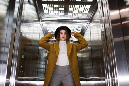 fashionable woman in elevator