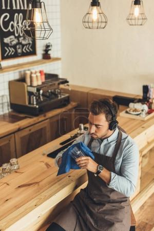 worker cleaning glassware