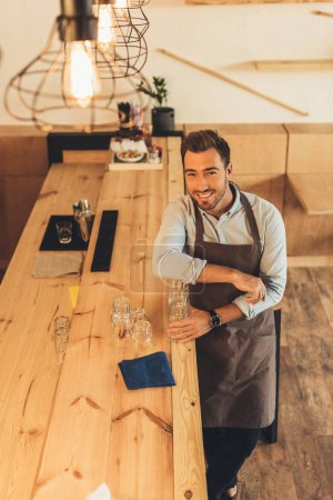 Barista standing at counter