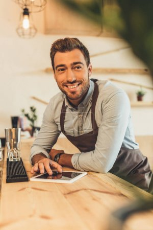 smiling barista with tablet