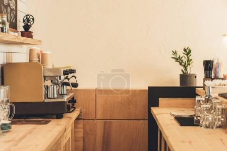 Photo for Coffee machine, glassware and paper cups in coffee shop - Royalty Free Image