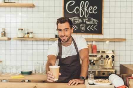 Photo for Portrait of smiling barista putting coffee to go on counter in cafe - Royalty Free Image
