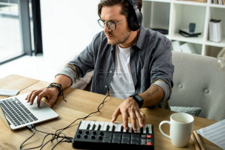 Photo for Young sound producer working at modern office - Royalty Free Image