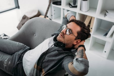 man relaxing at modern office