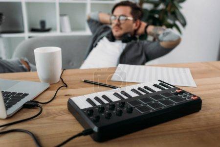 musician relaxing at modern office