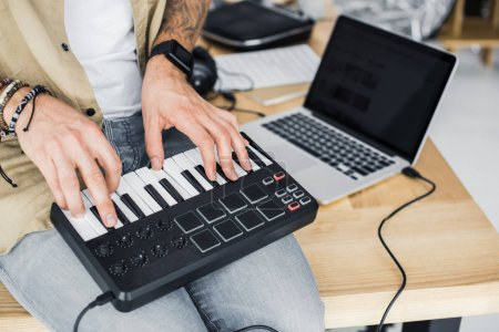 modern dj working with MPC pad