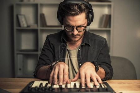 man working with keyboard controller