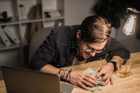 drunk man with heap of cash