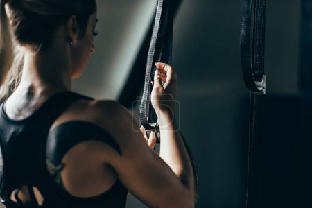 woman preparing gymnastic equipment
