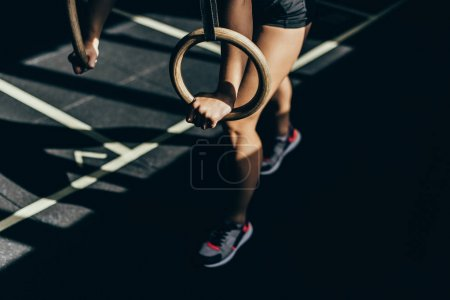 woman with gymnastic rings